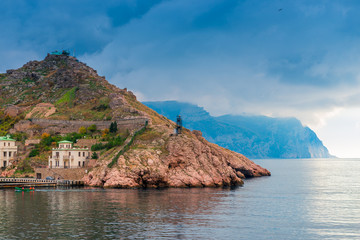 Mountains in the Balaklava Bay in Crimea, dramatic sky above the sea and mountains