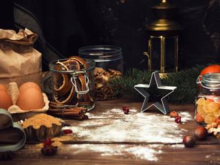 Winter (Christmas) baking ingredients on dark rustic background.