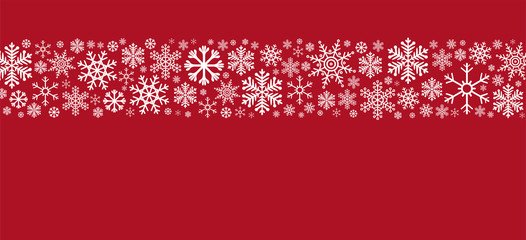 weisse Schneeblocken auf rotem Hintergrund
