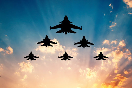 illustration of warplanes at sunset
