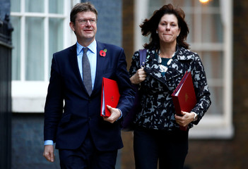 Britain's Secretary of State for Business, Energy and Industrial Strategy Greg Clark and Minister of State for Energy and Clean Growth Claire Perry arrive in Downing Street in London