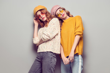 Two Girls Having Fun. Fashion Autumn Outfit Wall mural