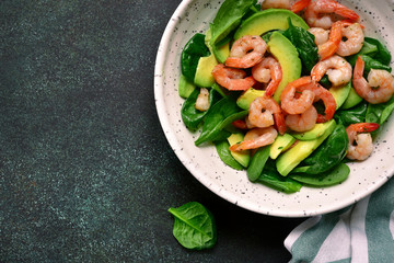 Avocado salad with baby spinach and shrimps.Top view.