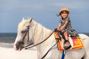 Close up portrait of kids and horse . little girl ride a horse and Tenderness and caring for White...