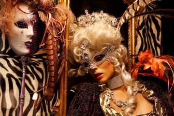 Carnival window dressing mannequin mask and costume at the traditional festival in Venice, Italy