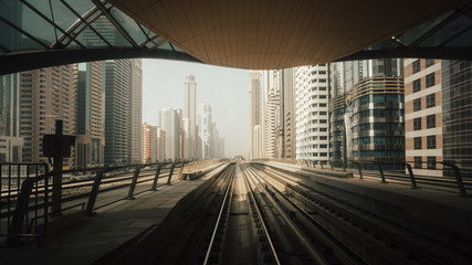View from first railway carriage. Dubai city metro in the downtown