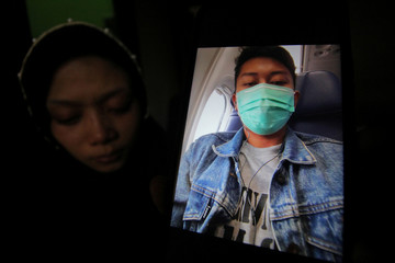 Lutfiani shows undated picture of her husband, Deryl Fida Febrianto, a passenger on Lion Air flight JT610 at her house in Surabaya