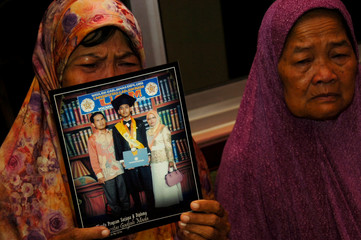 Mother shows a picture of her son, Agil Nugroho Septian, Lion Air flight JT610 passenger, at her house in Tegal
