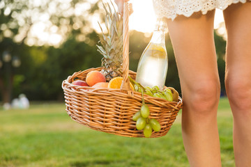 Close up of a woman holding picnic basket