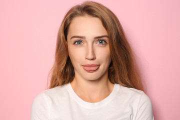 Portrait of funny young woman on color background