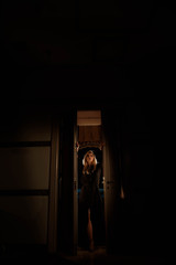 silhouette of a girl in the door