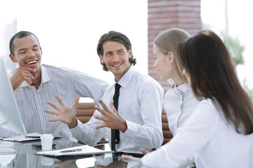 businessman talking to a business team sitting at Desk.