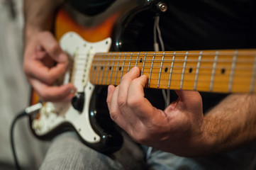 Closeup fingers of guitar player