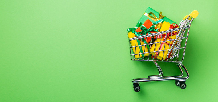 Online shopping concept - trolley cart full of presents. Black Friday and Ciber Mondey