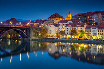Maribor, Slovenia. Cityscape image of Maribor, Slovenia during autumn twilight blue hour with reflection of the city in Drava River.