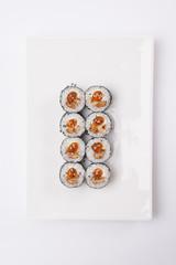 Traditional japanese sushi rolls on white background