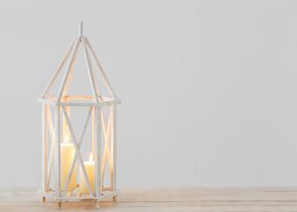 white lantern with burning candles