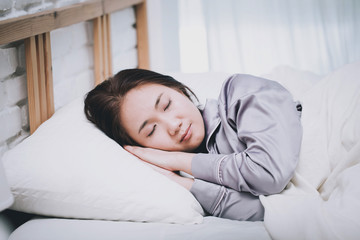 Beautiful Attractive Asian woman sleep and sweet dream on bed in bedroom in the morning,Healthcare Concept