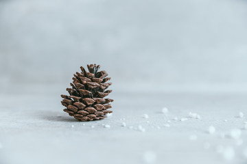 Pine cone on rustic white wood table, Christmas decoration background. Winter greeting card