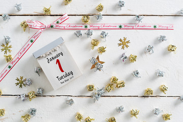 tear-off calendar surrounded by christmas decoration and with the 1st of january 2019 on top