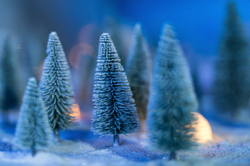 Christmas trees with heavy snow and bokeh