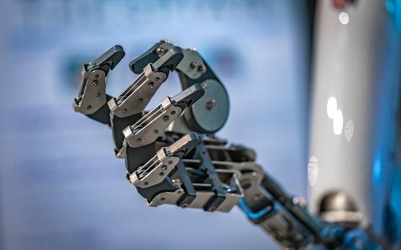 Robotic Hand Mechanism With A DC Servo Motors, Tendon Actuator And Rotating Fingertips