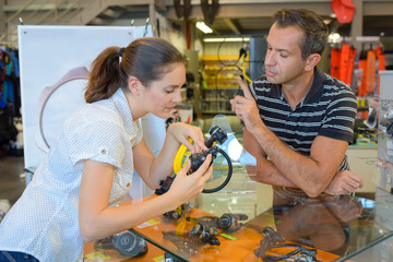 female diver getting advice about diving mouthpieces in diving shop