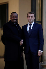 French President Emmanuel Macron welcomes Ethiopia's Prime Minister Abiy Ahmed before their meeting at the Elysee Palace in Paris