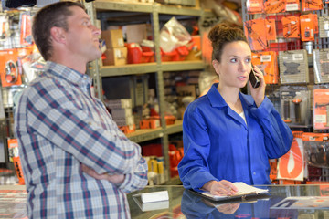 woman using phone in distribution warehouse