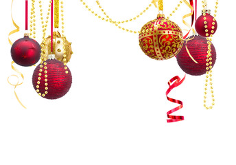 Red and golden hanging christmas balls with garlands isolated over white background