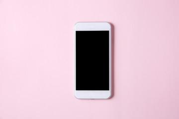 ピンク背景に白いスマートフォン