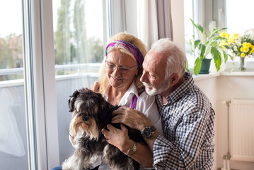 Happy senior couple with dog