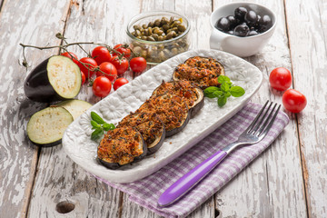 baked eggplant filled with caper tomatoes and black olives