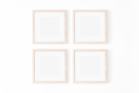 Set of four square frmes with passe-partout. Wooden frame mockup on white wall. Poster mockup. Clean, modern, minimal frame. Empty fra.me Indoor interior, show text or product