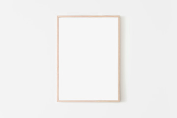 Portrait large 50x70, 20x28, a3,a4, Wooden frame mockup on white wall. Poster mockup. Clean, modern, minimal frame. Empty fra.me Indoor interior, show text or product Wall mural