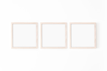 Set of three square Wooden frame mockup on white wall. Poster mockup. Clean, modern, minimal frame. Empty fra.me Indoor interior, show text or product