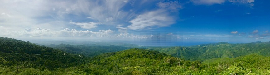 Mirador Lookout Point Panorama close to Trinidad (Sancti Spiritus) in the Cuban Countryside (Caribbean island) with a lush green vegetation and a blue summer sky with white clouds Wall mural