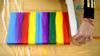 Painting rainbow on canvas, gay pride, transsexuality concept