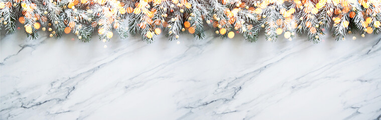 Christmas and New Year holiday background. Xmas greeting card. Spruce tree on white marble background.