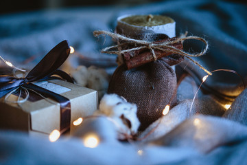 Cozy winter composition with eco gifts and christmas lights, flat lay, mock up, macro photo