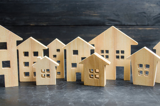 Wooden city and houses. concept of rising prices for housing or rent. Growing demand for housing and real estate. The growth of the city and its population. Investments. agglomeration and urbanization