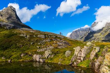 Person mountain biking in Trollstigen, Norway