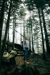 A girl in the middle of a forest