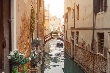 Venice, beautiful romantic italian city on sea with great canal and gondolas. View of venetian narrow canal. Venice is a popular tourist destination of Europe.