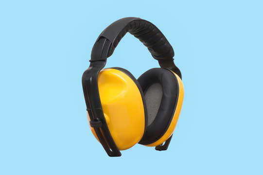 Earmuffs of safety gear and workwear on blue background construction