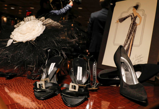 Shoes and a hat worn by singer Aretha Franklin are displayed during press preview for Julien's Auctions annual Icons and Idols sale in New York