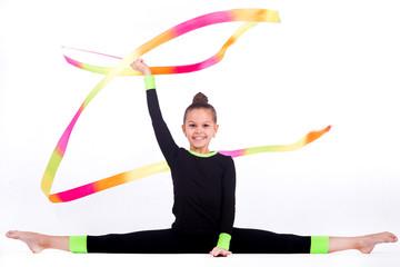 Foto auf Leinwand Gymnastik Teenager girl doing rhythmic gymnastics exercises on white background