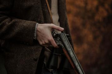 Huner with gun on field
