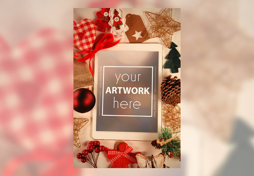 Tablet and Holiday Decorations on Table Mockup
