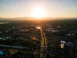 Aerial drone photo - Highways of Denver Colorado leading to the Rocky Mountains at Sunset